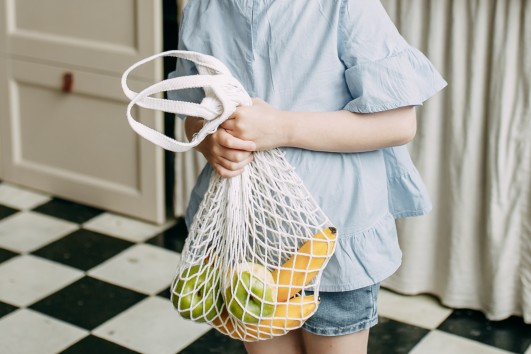 girl with an eco fruit bag